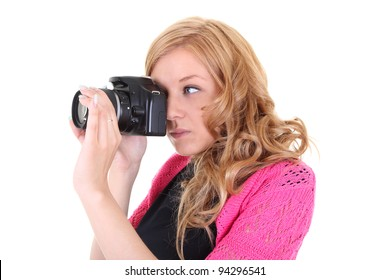Woman with digital camera in hands over white