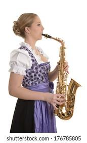 Woman in dirndl dress playing saxophone, Studio Shot