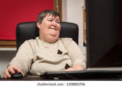 woman with a disability develop sitting at the computer, alternative Therapy and workout