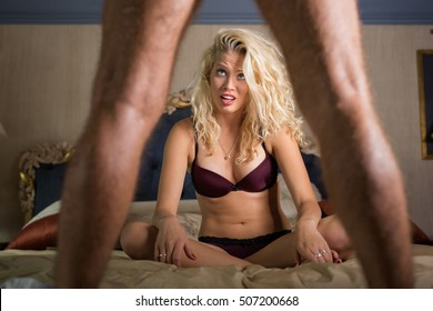 Woman in disbelief looking what's between man's legs