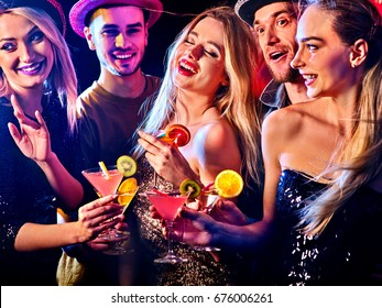 Woman disco night club. Cocktail party with group people dancing and drink cocktail. Women and men have fun in night club. Happy couple with alcohol drink . Wine disco.