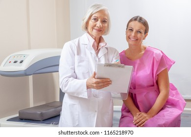 Woman discussing scan test at hospital with her female doctor.