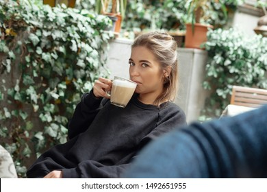 woman disgusting smell of coffee with face expression, girl does not enjoy the smell of drink, woman disliking smell of coffee making negative face expression