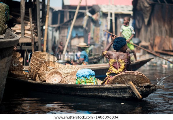 A woman displaying her wares in a local community in Makoko, the Stilts village, Lagos / Nigeria taken on the 18th of May, 2019