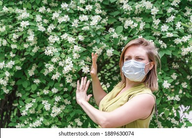 a woman in a disposable medical mask is allergic to bloom