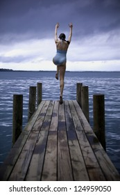 Woman diving off dock