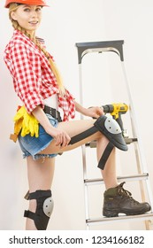 Woman with DIY toolbelt. Girl working at flat remodeling. Building, repair and renovation.