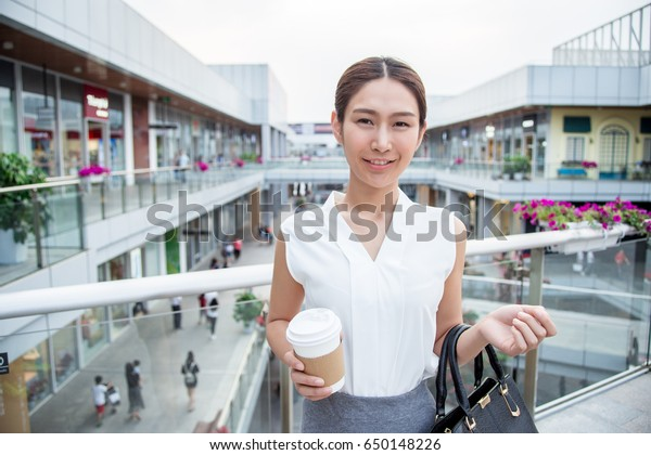 woman do shopping with coffee