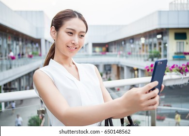 woman do shopping and talking to cellphone