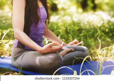 Woman do yoga outdoor. Woman exercising vital and meditation for fitness lifestyle club at the nature background.