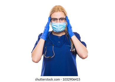 Woman doctor in blue scrubs and gloves