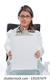 Woman doctor at desk holding white paper