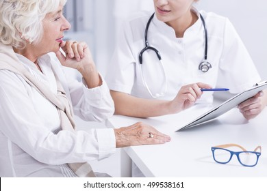 Woman doctor explaining the medical results to the senior woman