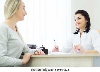 woman doctor with female patient.