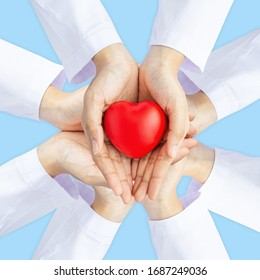 Woman doctor hands holding red heart on wide blue background donate for foundation hospital blood care concept Square world heart and health day, People CSR community, foster support children organ