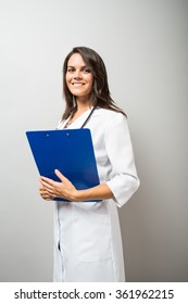 Woman doctor holding a document