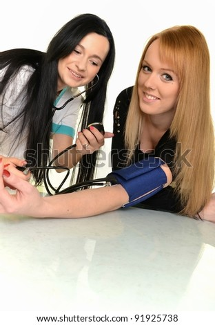 Woman Doctor Measuring Blood Pressure By Stock Photo (Edit