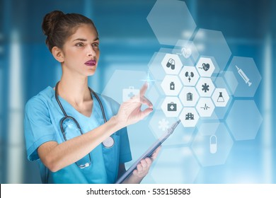 woman doctor or nurse concept that is using innovative technologies to manage her work in the hospital, mixed media with copy space for advertising
