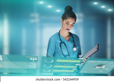 woman doctor or nurse futuristic concept, that is using a holographic medical workstation panel in order to monitor health data of a patient in the hospital, advertising image with copy space