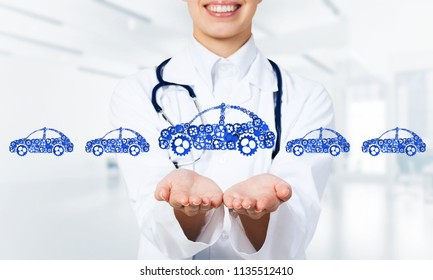 Woman doctor presenting in palms concept of car transporation or insurance