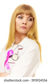 Woman doctor with stethoscope and pink ribbon aids symbol on chest. Healthcare, medicine breast cancer awareness concept.