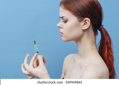 Woman doctor with a syringe in his hand