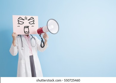 woman doctor take angry billboard and microphone isolated on blue background,asian