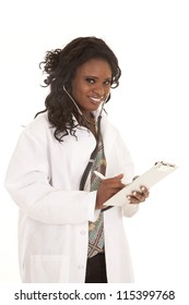 A woman doctor taking notes on her clip board.