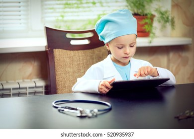 Woman doctor using tablet computer in hospital