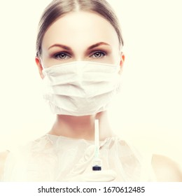 Woman doctor wearing medical mask hold syringe vaccine. Health care