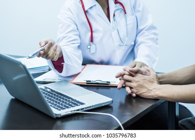 A woman doctor in white uniform gown coat interview consulting patient. Medical concept.