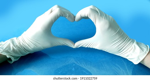 Woman doctor's hands in white gloves in heart shape. Medical, stay home concept,
