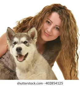 woman with dog Alaskan malamute