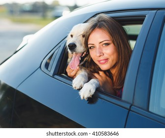 Woman and dog in car on summer travel. Vacation with pet concept