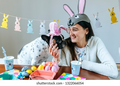 Woman with dog celebrating easter