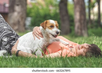 Woman and dog chilling in a park