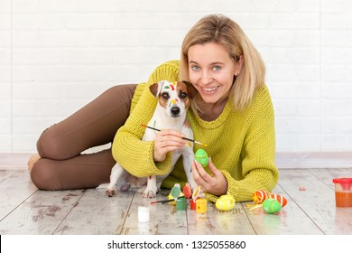 Woman and dog color Easter eggs