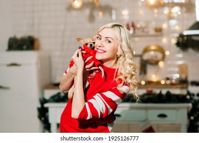 Woman and dog enjoying in cuddling in Christmas time, blonde female