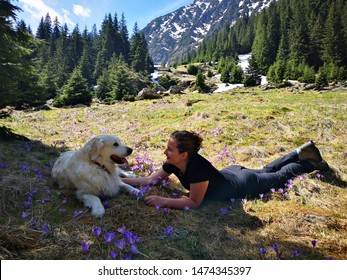 woman and dog enjoying summer in the mountains