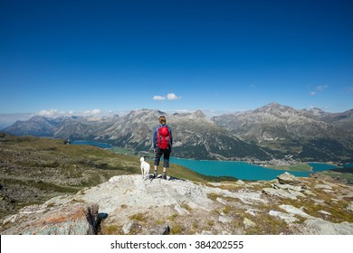 Woman and dog hiking in Switzerland