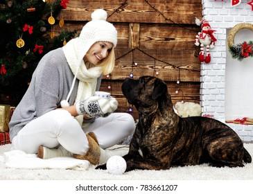 woman and dog near Christmas tree