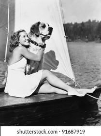 Woman and dog on sailboat