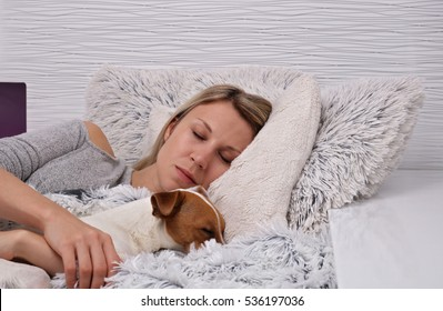 Woman and dog sleeping together. Pet Allergies concept