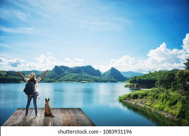 woman with a dog in the summer landscape