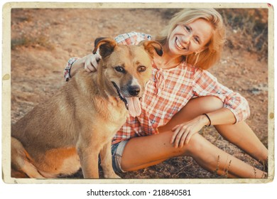 woman with dog in summertime