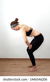 Woman doing abdominal hypopressives indoor