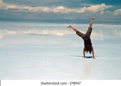 Woman doing acrobatics on ice