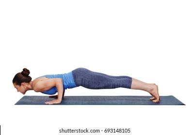 Woman doing Ashtanga Vinyasa yoga Surya Namaskar Sun Salutation asana Chaturanga Dandasana - four-limbed staff pose isolated