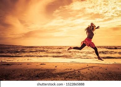 Woman doing beach run on the beach at sunset