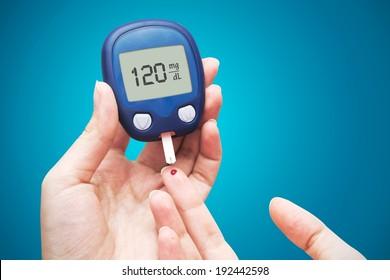 Woman doing blood sugar test